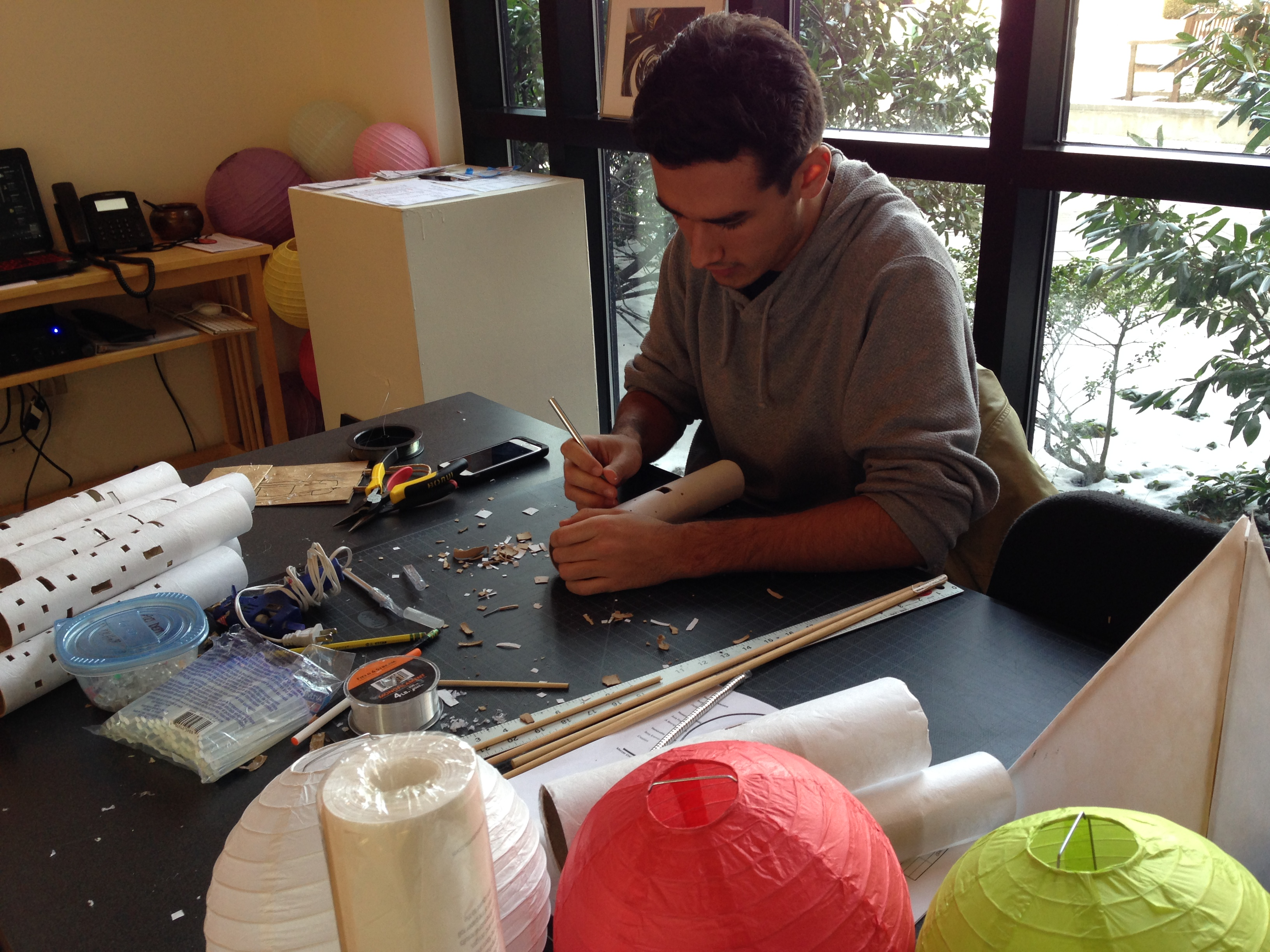 Artist in gallery working on project